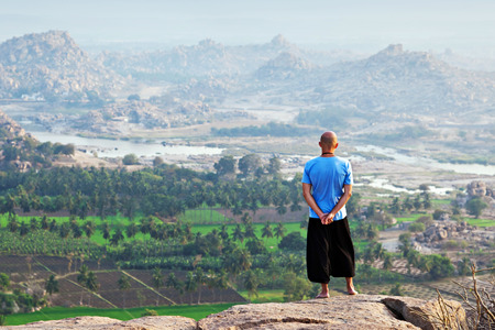 far away: Men looking far away, Hampi, India Stock Photo
