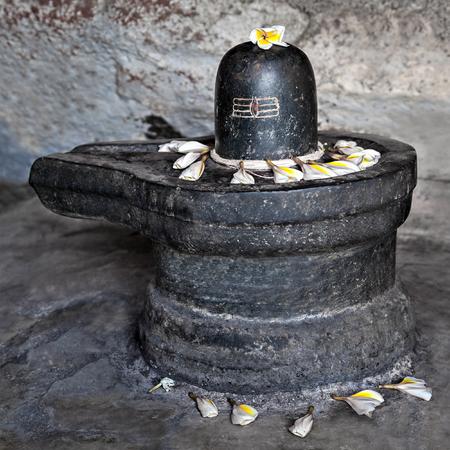 linga: Monolith shiva lingam in the cave, India