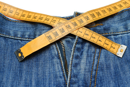 Jeans and tape measure isolated Stock Photo