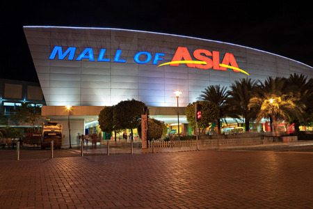 sm: MANILA, PHILIPPINES - FEBRUARY 23: SM Mall of Asia (MOA) is a 2nd largest mall in the Philippines on February 23, 2013 in Manila, Philippines. It has a land area of 42 hectares and has gross floor area of an approximate 390193 meters Editorial