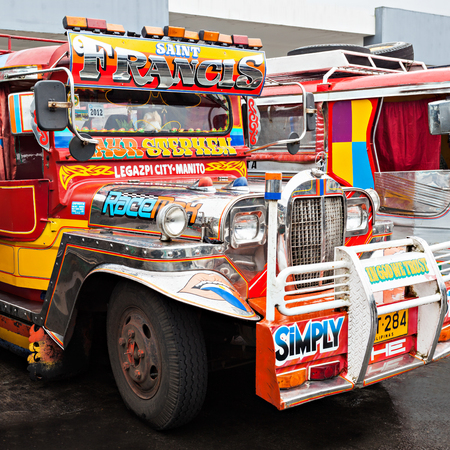 taxi famous building: MANILA, PHILIPPINES - FEBRUARY 25: Jeepney on the bus station on February, 25, 2013, Manila, Philippines. Jeepney is a most popular public transport on Philippines. Editorial