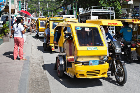 means of transport: BORACAY, PHILIPPINES - MARCH 04: Tricycle on the street, March 04, 2013, Boracay, Philippines. Motorized tricycles are a common means of passenger transport everywhere in the Philippines.