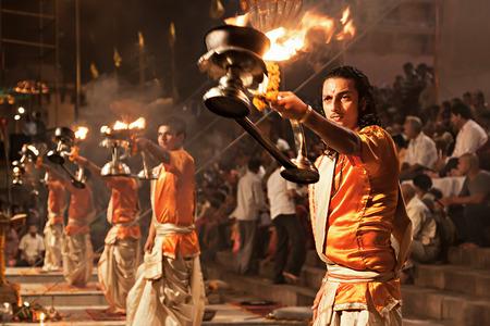 uttar: VARANASI, INDIA - APRIL 11: An unidentified Hindu priest performs religious Ganga Aarti ritual (fire puja) at Dashashwamedh Ghat on April 11, 2012 in Varanasi, Uttar Pradesh, India Editorial