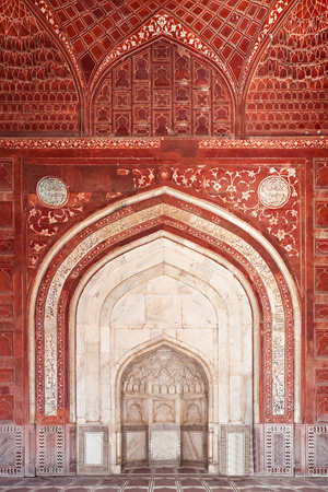 universally: AGRA, INDIA - APRIL 10: Pattern on Taj Mahal on April 10, 2012 in Agra, India. Taj Mahal is widely recognized as the jewel of Muslim art and one of the universally masterpieces of the world