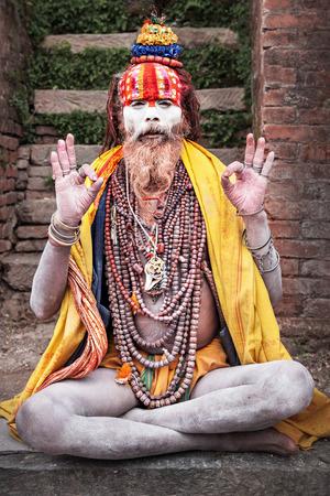 ascetic: KATHMANDU - APRIL 15: Sadhu at Pashupatinath Temple in Kathmandu, Nepal on April 15, 2012. Sadhus are holy men who have chosen to live an ascetic life and focus on the spiritual practice of Hinduism