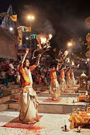 benares: VARANASI, INDIA - APRIL 11: An unidentified Hindu priest performs religious Ganga Aarti ritual (fire puja) at Dashashwamedh Ghat on April 11, 2012 in Varanasi, Uttar Pradesh, India Editorial