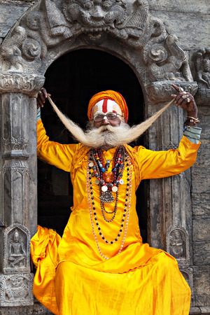 ascetic: KATHMANDU - APRIL 15: A sadhu at Pashupatinath Temple in Kathmandu, Nepal on April 15, 2012. Sadhus are holy men who have chosen to live an ascetic life and focus on the spiritual practice of Hinduism Editorial