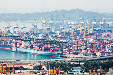tonnage: SINGAPORE - OCTOBER 18, 2014: The port of Singapore. Its the worlds busiest transshipment port and the worlds second busiest port in terms  of total shipping tonnage.