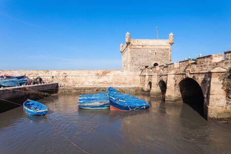 skala: Boats docked in the Skala du Port in Essaouira, Morocco. Essaouira is a city in the western Moroccan region on the Atlantic coast.