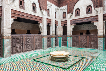 MEKNES, MOROCCO - FEBRUARY 29, 2016: Pattern design element of the Madrasa Bou Inania in Meknes, Morocco. Madrasa Bou Inania is acknowledged as an excellent example of Marinid architecture in Meknes.