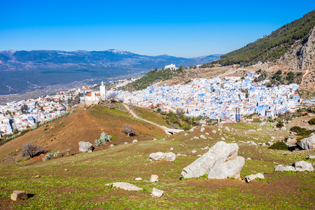 noted: Chefchaouen aerial panoramic view, Morocco. Chefchaouen is a city in northwest Morocco. Chefchaouen is noted for its buildings in shades of blue.