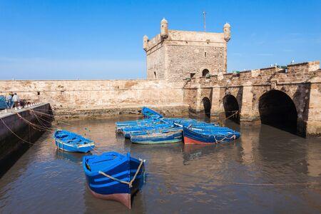 Boats docked in the Skala du Port in Essaouira, Morocco. Essaouira is a city in the western Moroccan region on the Atlantic coast.