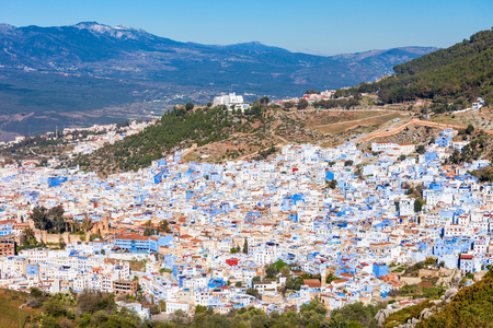 Chefchaouen and Rif mountains aerial panoramic view, Morocco. Chefchaouen is a city in northwest Morocco. Chefchaouen is noted for its buildings in shades of blue.