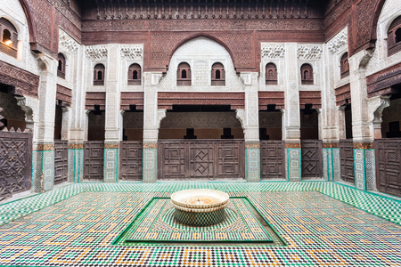 fes: MEKNES, MOROCCO - FEBRUARY 29, 2016: Pattern design element of the Madrasa Bou Inania in Meknes, Morocco. Madrasa Bou Inania is acknowledged as an excellent example of Marinid architecture in Meknes.