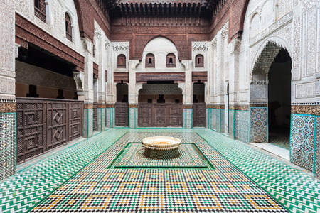 MEKNES, MOROCCO - FEBRUARY 29, 2016: Madrasa Bou Inania interior in Meknes, Morocco. Madrasa Bou Inania is acknowledged as an excellent example of Marinid architecture in Meknes.