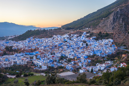 Chefchaouen aerial panoramic view at night. Chefchaouen is a city in northwest Morocco. Chefchaouen is noted for its buildings in shades of blue.