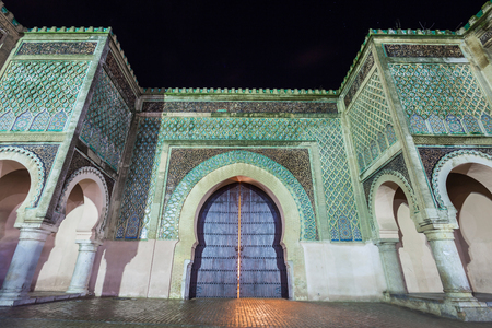 bab: The Bab Mansour in Meknes, Morocco at night. Gate Bab Mansour Gate named after the architect, El-Mansour. Gate Bab Mansour is a main gate in Meknes, Morocco. Editorial
