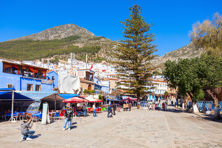 CHEFCHAOUEN, MOROCCO - MARCH 01, 2016: Central city square in Chefchaouen. Chefchaouen is a city in northwest Morocco. Chefchaouen is noted for its buildings in shades of blue.