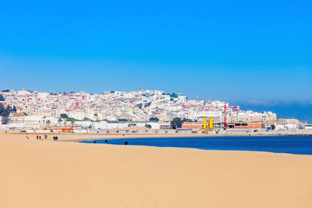 Tangier city beach in Tangier, Morocco. Tangier is a major city in northern Morocco. Tangier located on the North African coast at the western entrance to the Strait of Gibraltar. Stock Photo