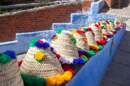 Traditional Berber Hats In Chefchaouen in northwest Morocco. Chefchaouen is noted for its buildings in shades of blue. Stock Photo