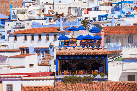 noted: Chefchaouen aerial panoramic view. Chefchaouen is a city in northwest Morocco. Chefchaouen is noted for its buildings in shades of blue. Stock Photo