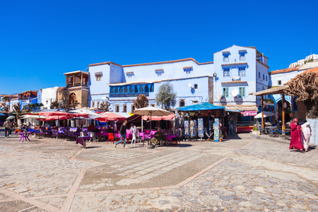 noted: CHEFCHAOUEN, MOROCCO - MARCH 01, 2016: Central city square in Chefchaouen. Chefchaouen is a city in northwest Morocco. Chefchaouen is noted for its buildings in shades of blue.