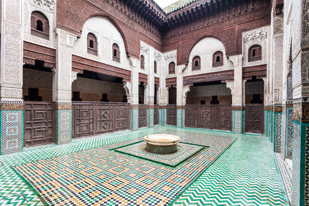 acknowledged: MEKNES, MOROCCO - FEBRUARY 29, 2016: Madrasa Bou Inania interior in Meknes, Morocco. Madrasa Bou Inania is acknowledged as an excellent example of Marinid architecture in Meknes.