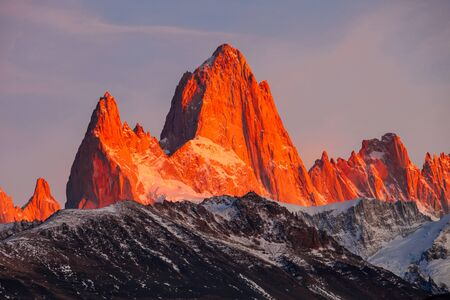 chalten: Fitz Roy sunrise view. Fitz Roy is a mountain near El Chalten in Patagonia, on the border between Argentina and Chile. Stock Photo