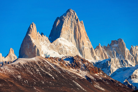cerro fitzroy: Fitz Roy sunrise view. Fitz Roy is a mountain near El Chalten in Patagonia, on the border between Argentina and Chile. Stock Photo
