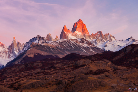 Monte Fitz Roy (also known as Cerro Chalten) aerial sunrise view. Fitz Roy is a mountain located near El Chalten, in the Southern Patagonia, on the border between Argentina and Chile. Stock Photo