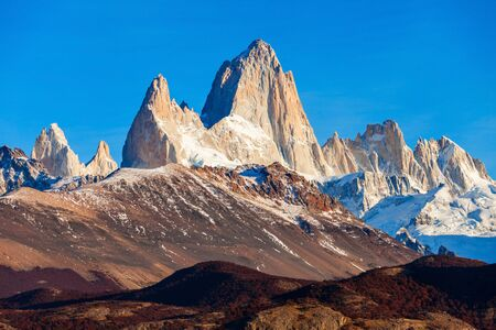 chalten: Monte Fitz Roy (also known as Cerro Chalten) aerial sunrise view. Fitz Roy is a mountain located near El Chalten, in the Southern Patagonia, on the border between Argentina and Chile. Stock Photo