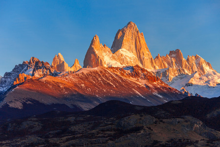 cerro chalten: Fitz Roy sunrise view. Fitz Roy is a mountain near El Chalten in Patagonia, on the border between Argentina and Chile. Stock Photo