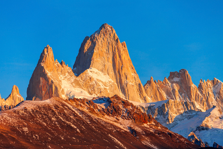 Fitz Roy close up sunrise view. Fitz Roy is a mountain located near El Chalten, in the Southern Patagonia, on the border between Argentina and Chile.