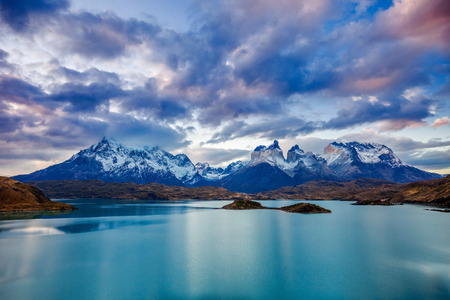 The Torres del Paine National Park sunset view. Torres del Paine is a national park encompassing mountains, glaciers, lakes, and rivers in southern Patagonia, Chile. Banque d'images