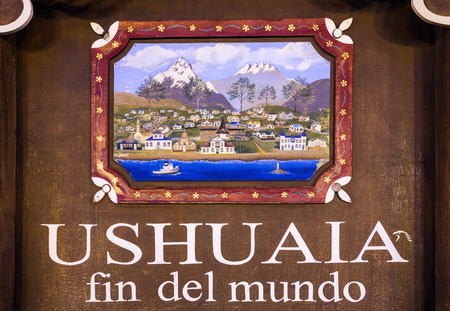 end of the world: USHUAIA, ARGENTINA - APRIL 15, 2016: Ushuaia Fin Del Mundo (End Of The World) sign. Ushuaia is the capital of Tierra del Fuego province in Argentina.