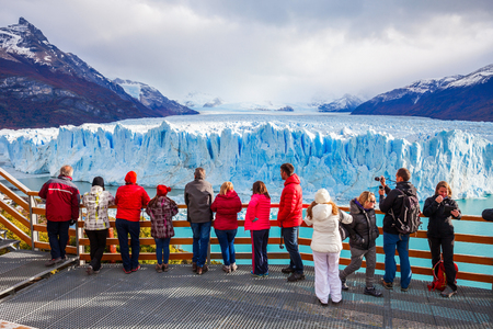EL CALAFATE, ARGENTINA - APRIL 21, 2016: Tourists near the Perito Moreno Glacier, Argentina. Perito Moreno is a glacier located in the Los Glaciares National Park in Patagonia, Argentina.