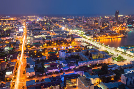 Yekaterinburg aerial panoramic view at night. Ekaterinburg is the fourth largest city in Russia and the centre of Sverdlovsk Oblast located in the Eurasian continent on the border of Europe and Asia. Stock Photo
