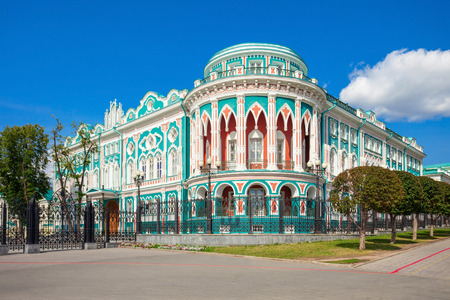 ural: Sevastyanov House (also House of Trade Unions) in Yekaterinburg in Russia. Its a palace built in the first quarter of XIX century on the banks of the city pond, formed by a dam on the Iset River.