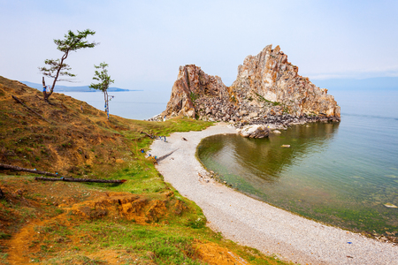 shamanism: Shamanka (Shamans Rock) on Baikal lake near Khuzhir at Olkhon island in Siberia, Russia. Lake Baikal is the largest freshwater lake in the world.