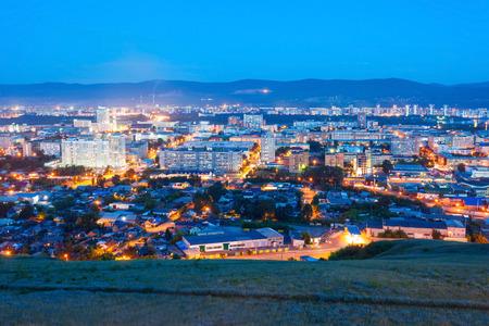 top veiw: Krasnoyarsk city aerial panoramic view from Karaulnaya Mountain viewpoint in Krasnoyarsk at night, Russia