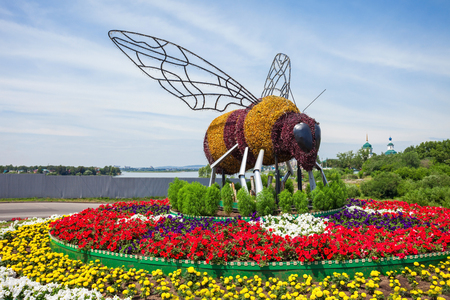 IRKUTSK, RUSSIA - JULY 07, 2016: The Bee monument near the Fortune shopping center in the center of Irkutsk city, Russia.