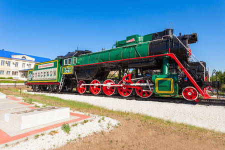 ULAN-UDE, RUSSIA - JULY 15, 2016: Retro steam locomotive parovoz near the Ulan-Ude railway station in Ulan Ude city in Buryatia, Russia. Editorial