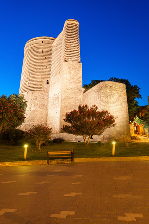 azeri: The Maiden Tower at night. It is also known as Giz Galasi and located in the Old City in Baku, Azerbaijan. Editorial