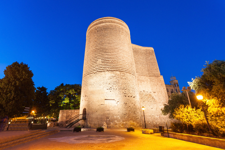 azeri: The Maiden Tower at night. It is also known as Giz Galasi and located in the Old City in Baku, Azerbaijan. Stock Photo