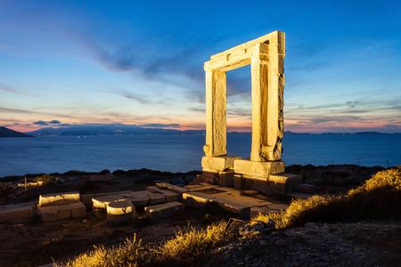 Naxos Portara or Apollo Temple entrance gate on Palatia island near Naxos island in Greece at night Stock Photo