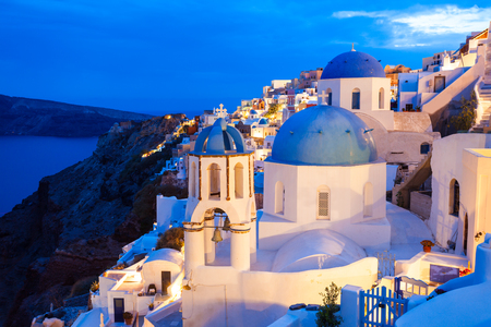 Oia Church dome in the Oia town at sunset, Santorini island in Greece