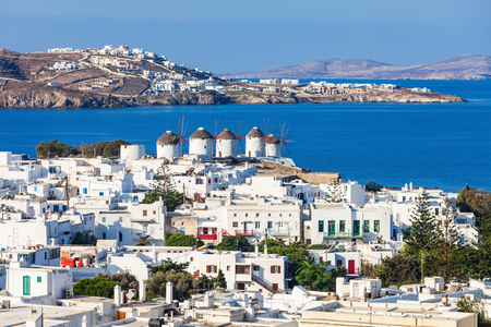 The Mykonos windmills are iconic feature of the Greek island of the Mykonos. The island is one of the Cyclades islands in the Aegean Sea, Greece. Stock Photo