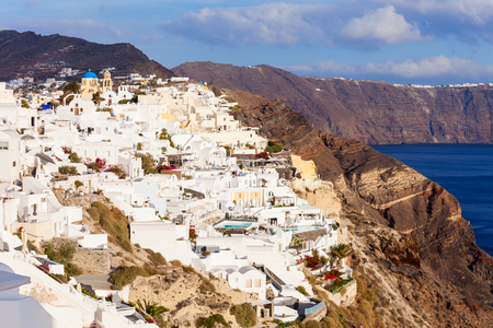 Oia town aerial panoramic view. Oia or Ia is a small town on Santorini island in the Cyclades, Greece. Stock Photo