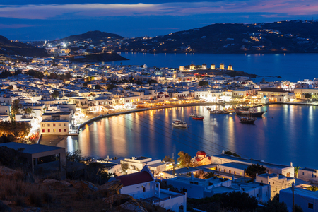 Mykonos island aerial panoramic view at night. Mykonos is a island, part of the Cyclades in Greece.