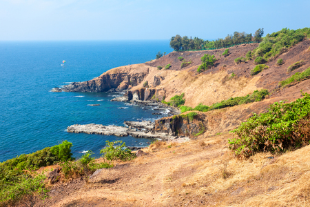 Beauty rocks on Sinquerim Beach aerial panoramic view. Its located near the Fort Aguada and its lighthouse in Goa, India.